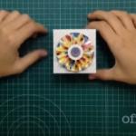 Cómo hacer una caja de cartón con una flor acordeón para decorar